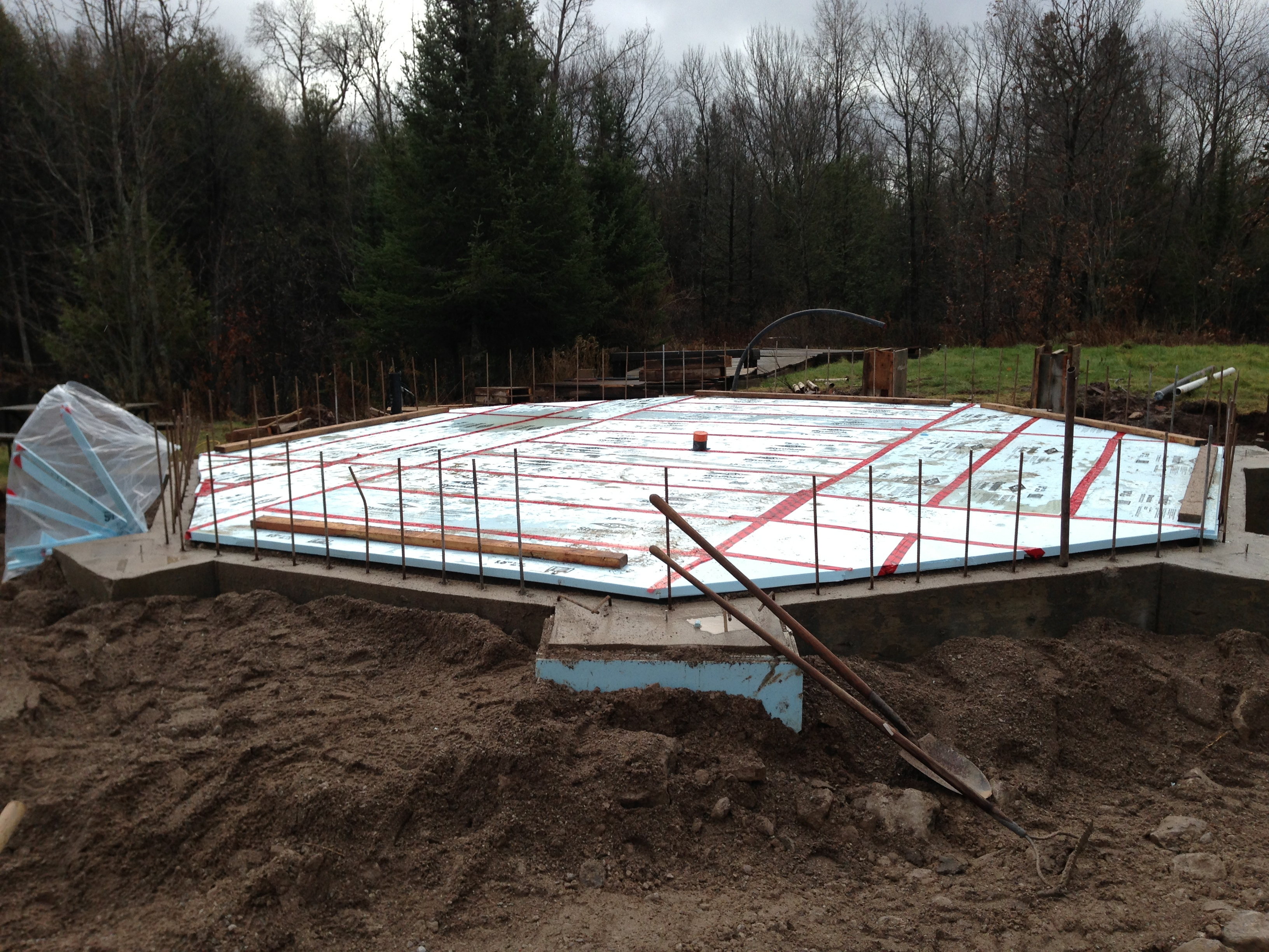 sea container cabin foundations 10 back filled and insulated octagon