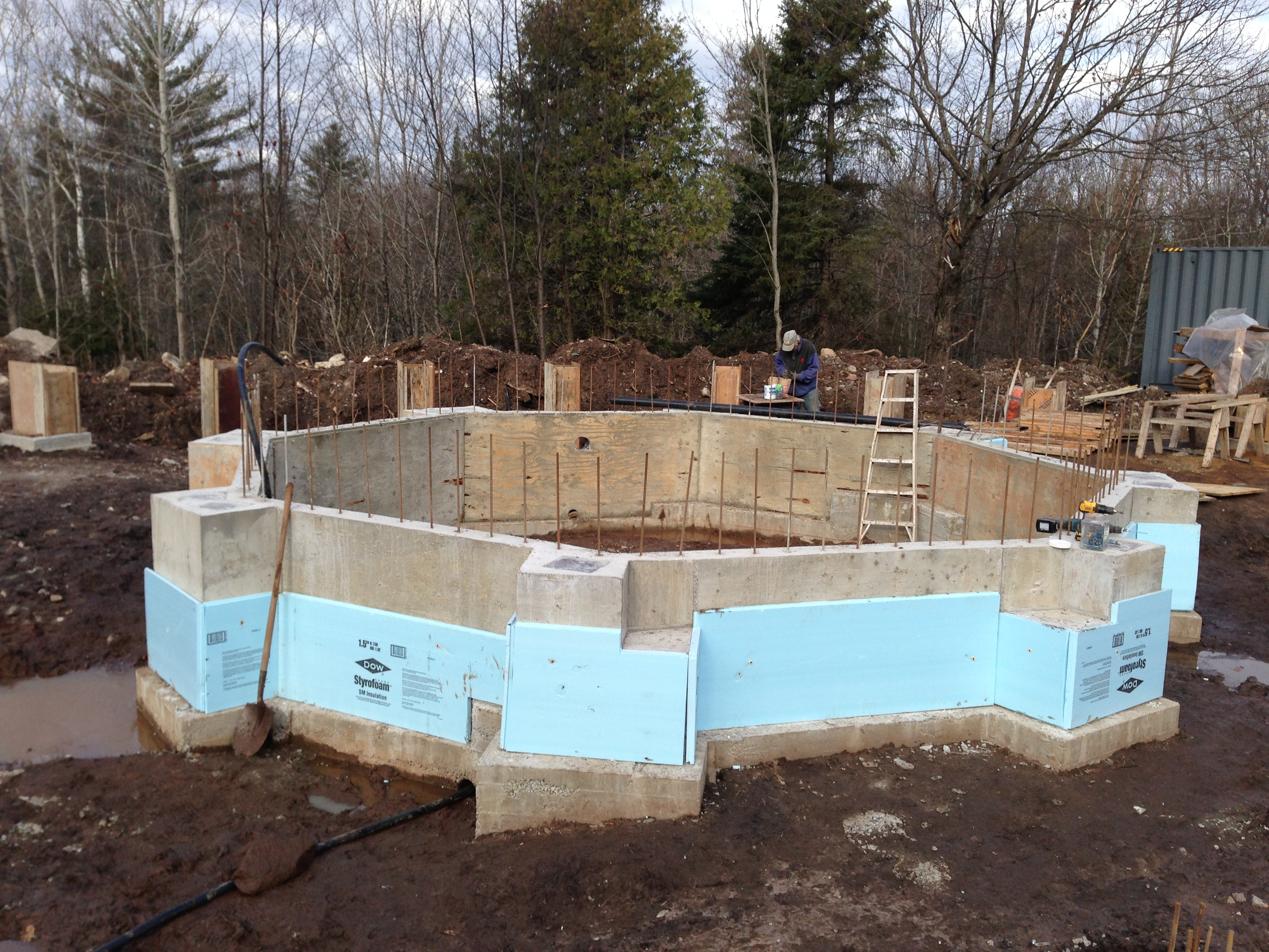 Minimizing foundations work with shipping containers sea for Poured wall foundation
